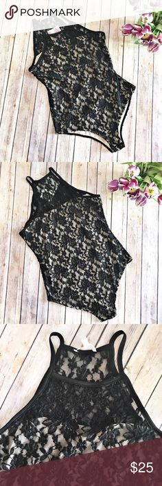 love, FIRE Black Lace w/ Nude underlay bodysuit NWT love, FIRE Black Lace w/ Nude underlay bodysuit.  Has snap closure and sheer neckline.  Pair with a black pencil skirt, skinny jeans, or whatever you heart desires.  Super sexy.  See pictures for measurements. love, FIRE Tops