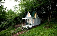 Tiny Victorian Cottage. I think I need one in the backyard.