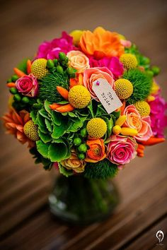www.kateaveryflowers.co.uk Colourful bridal bouquet Yellow, green, orange & pink with chillies