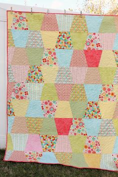 "Today is my turn to share a new project as part of the Riley Blake Design Team. For this tutorial, I am teaching how to make a 'tumbler' quilt – a fun variation on traditional patchwork. I used Lori Holt's Large ""Thimble"" ruler as my template. (You can see more of Lori's cool ruler shapes …"