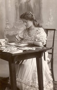 Pretty lady writing a love letter.