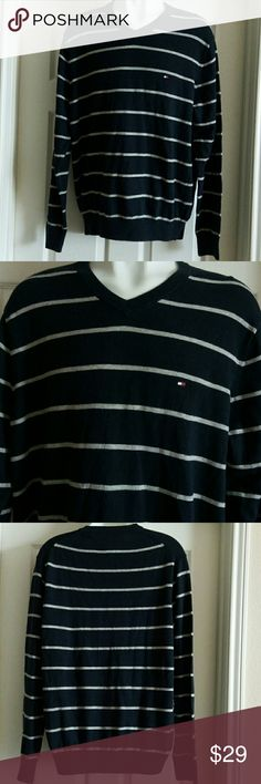 """Tommy Hilfiger men's Sweater Top New with tags Tommy Hilfiger men's long sleeve sweater Top. Size Large. V neck cut, stripe.  Color: blue and grey. Chest:44"""" Length: 28"""" Tommy Hilfiger Sweaters V-Neck"""