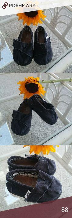 Black Kids Toms Shoes- Size T4 Cute kids toms. Black Velcro strap on front. Has some color fading on the front with some fraying of the Velcro strap. Images attached. Toms Shoes