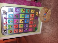 Alivia's alphabet magnet board.  Made from an auto drip pan :)