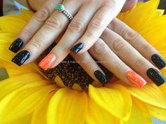Acrylic nails with black gelish gel polish ,bright orange gelish gel polish on ring fingers