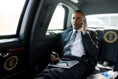 President Barack Obama talks on the phone with Aurora Mayor Steve Hogan (movie theather shooting spree) during the motorcade ride to Palm Beach International Airport in Palm Beach, Fla., July 20, 2012. The President called Mayor Hogan to offer his condolences and support to the Aurora community. (Official White House Photo by Pete Souza)