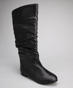 Pleasing to pull on and stylish to wear, this slouchy pair has plenty of appeal. Plus, with a glossy finish and flat heel, these boots are kind to feet and truly trend-friendly. 0.5'' heel15.5'' shaft16'' circumferencePull-onMan-made