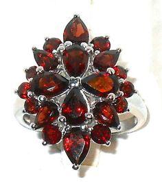 5.34carats Genuine Mozambique Red Garnet cocktail Ring Size 7     http://www.ebay.com/itm/271065979711?ssPageName=STRK:MESELX:IT&_trksid=p3984.m1555.l2649