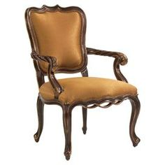 "Upholstered wood arm chair with a scrolling silhouette and nailhead trim.           Product: Chair    Construction Material: Wood and fabric    Color: Gold and brown     Features: Scrolling silhouetteNailhead trim              Dimensions: 40.75"" H x 26.25"" W x 28.5"" D"