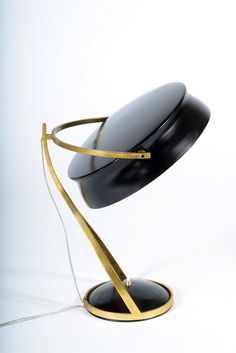 Mid-20th Century Adjustable Table Lamp Called Commander by Chiarini Milano | From a unique collection of antique and modern table lamps at https://www.1stdibs.com/furniture/lighting/table-lamps/