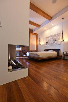 chimenea moderna en el dormitorio moderno