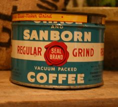 hand poured candles in vintage tins