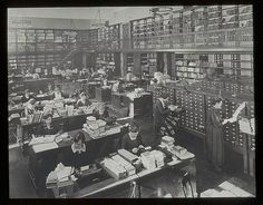 """Room 100, including card catalogs,"" by New York Public Library, via Flickr -- From what I can gather looking at other images and reading about this, it's behind the scenes in Cataloging, 1923."