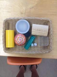 Opening and closing. They keep bringing the dice to this tray to put inside . June 2014 Toddler Montessori
