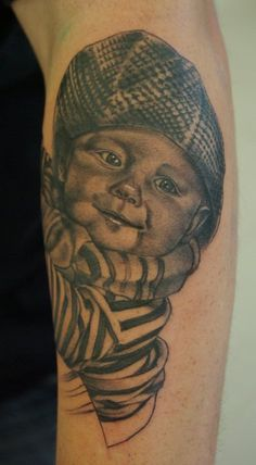 Black and grey realistic baby portrait from our custom tattoo artist Mark Watson who specialises in black and grey and realism.