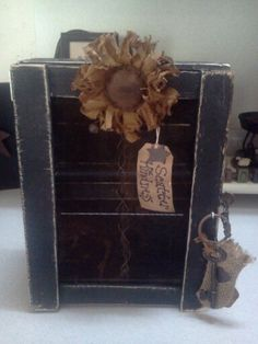Prim. Crate with rusty screen, skeleton key and sunflower. Made by Cindy's primitives.