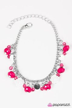 Faceted pink beads swing from the wrist in a flirtatious fashion. Infused with dainty crystal-like accents and shiny silver discs, white resin roses trickle bet
