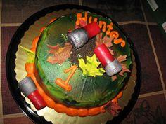 1st birthday camo cake with shot gun shells
