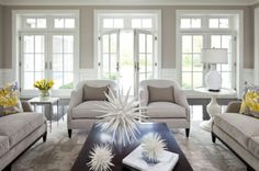 I love the white trim in this room and notice the white accessories on the dark table...makes it POP!