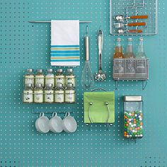 We recently reorganized our laundry room. I had some leftover pegboard from another project I did (jewelry pegboard organizer. Pegboard Ikea, Painted Pegboard, Pegboard Garage, Pegboard Organization, Kitchen Organization, Kitchen Pegboard, Kitchen Backsplash, Kitchen Storage, Laundry Craft Rooms