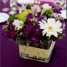 Centerpiece ideas... love these colors if its a spring wedding! gotta go purples for sure :)