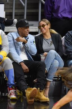 We love Beyoncé's court side style! The singer always looks *oh* so chic.  Business casual:Beyoncé layered a tailored black blazer over a heather grey tee, rolled up skinny jeans and heeled sandals.