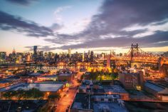 New York City Skyline: Have a beautiful evening taking in the skyline views at dusk from a rooftop in Long Island City, Queens.
