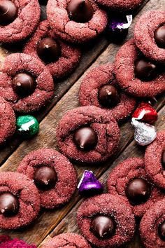 These red velvet kiss cookies are like peanut butter blossoms with Hershey's Kisses but made with soft-baked red velvet cookies. Perfect for Christmas cookie platters! Recipe on sallysbakingaddiction.com