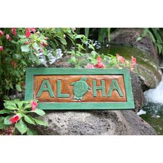 ALOHA sign from Makana Hut, featuring a hand carved Honu (Hawaiian Sea Turtle) in the middle of Aloha. Hand carved and painted. Measures x