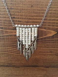 Handmade Cylinder Pearl, Arrow, Silver tone feathers that dangle, Silver Tone Long Chain Necklace that hangs 26 inches with a lobster clasp