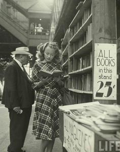 Women Reading - Barbara Laage shot by Nina Leen, LIFE Magazine.   Fabulous full-skirted plaid dress, and BOOKS.