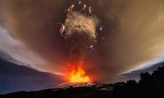 Volcanic lightning in the ash cloud as Mount Etna's Voragine crater erupts for the first time in two years.