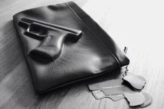Who needs mace when you can have a clutch with a leather embossed pistol? <3 it