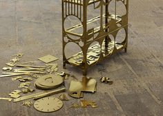 Parasite Production by Samuel Treindl - a clock, lamp and other products from shapes cut out of existing furniture