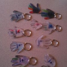 Key chains the daycare kids can make. Made from shrinky dink paper/plastic found in any craft store. Put a hand print on the paper and write a messp it in the oven and you have miniature hand keychains. Great Mother's/Father's Day present :) Daycare Crafts, Preschool Crafts, Crafts For Kids, Daddy Day, Mom Day, Fathers Day Presents, Fathers Day Crafts, Mother Day Message, Mother Day Gifts