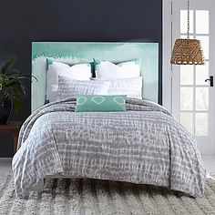Fun, yet sophisticated the Amy Sia Artisan Reversible Duvet Cover features a grey tie-dyed look for a chic, understated look. Reversing to a crisp, solid white with green accents, this duvet cover will revamp your bedroom style with a simple flip.