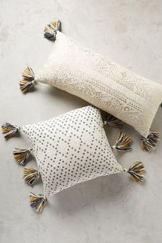 Tasseled Pointilliste Pillow - anthropologie.com in gold and turquoise