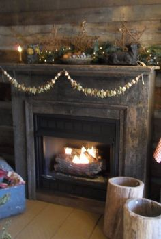 Rustic winter mantle is decorated not only Christmas, but for the entire Winter Season.  spiceridgeprimitives.