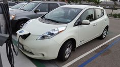 The Questions People Ask About The Nissan LEAF At A Charging Station