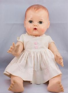 Loved my dolly.  We had an entire upstairs bedroom for a playroom.  Had tiny school, kitchen, bedroom, everything set up in that room.  Remember the trunks of doll clothesl and small ironing board and iron.  Much more fun then!