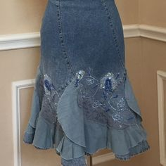 "Jeans skirt with embroidery and beading, size lg Girly jeans skirt features beading, embroidery and lace and a scalloped hem. The skirt has a casual ""undone"" vibe and could be styled boho or even southwestern. Size large, but runs small. Probably would fit a medium best. Hits at knee. Skirts Midi"