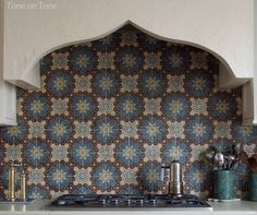 Stucco hood with Moroccan tile backsplash | Tone on Tone