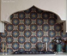 Stucco hood with Moroccan tile backsplash | Tone on Tone