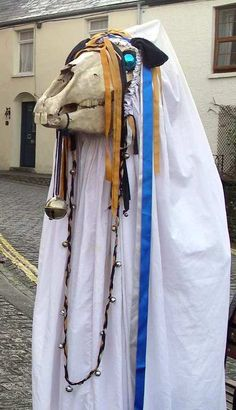 The Mari Lwyd or, in Welsh, Y Fari Lwyd, is a New Year custom once prevalent in the valleys of South Wales. Translated, the name means 'the Grey (or Holy) Mary' although this is likely a more recent rendering of 'the Grey Mare', as the tradition surrounding the Mari Lwyd involves the parading of a horse's skull.