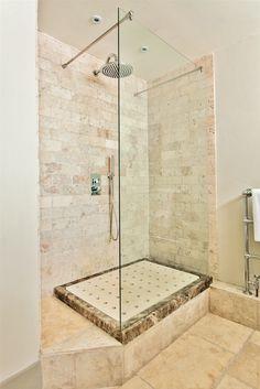 Raised show in basement bathroom to improve the drainage with Italian marble inset with Granada Beige limestone. #bathroom #interiordesign #shower