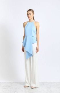 Architectural and modern, the New Air top will chic up your look.  Fabric: Blue crepe  Sleeveless. Crew neckline. Asymmetrical hemline. Hidden back zipper.