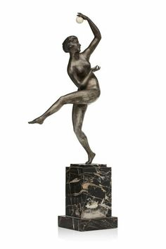 "A patinated bronze sculpture of a dancer, holding in her hand an ivory sphere, bu Maurice Guiraud Rivière.  Portor marble base. Signed ""Guiraud Rivière"" and stamped ""Etling Paris"".  H : 19,09 inch."
