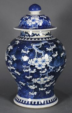 "Chinese underglazed blue porcelain lidded jar, of variant meiping form decorated with prunus on a blue ground, the base with a double ring mark, overall: 17.5""h"