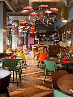 Bright colors and and natural materials, I want to eat here!  18 Fresh & Simple Restaurant Interiors