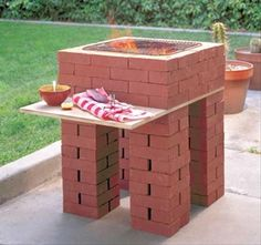Temporary Brick Barbeque with table. The 4th layer of brick down, counting from top, goes across the whole wooden board, thus creating a firewall between the fire and the wood.  ***** Referenced by 1 Dollar Web Hosting  (WHW1.com): WebSite Hosting - Affordable, Reliable, Fast, Easy, Advanced, and Complete.©